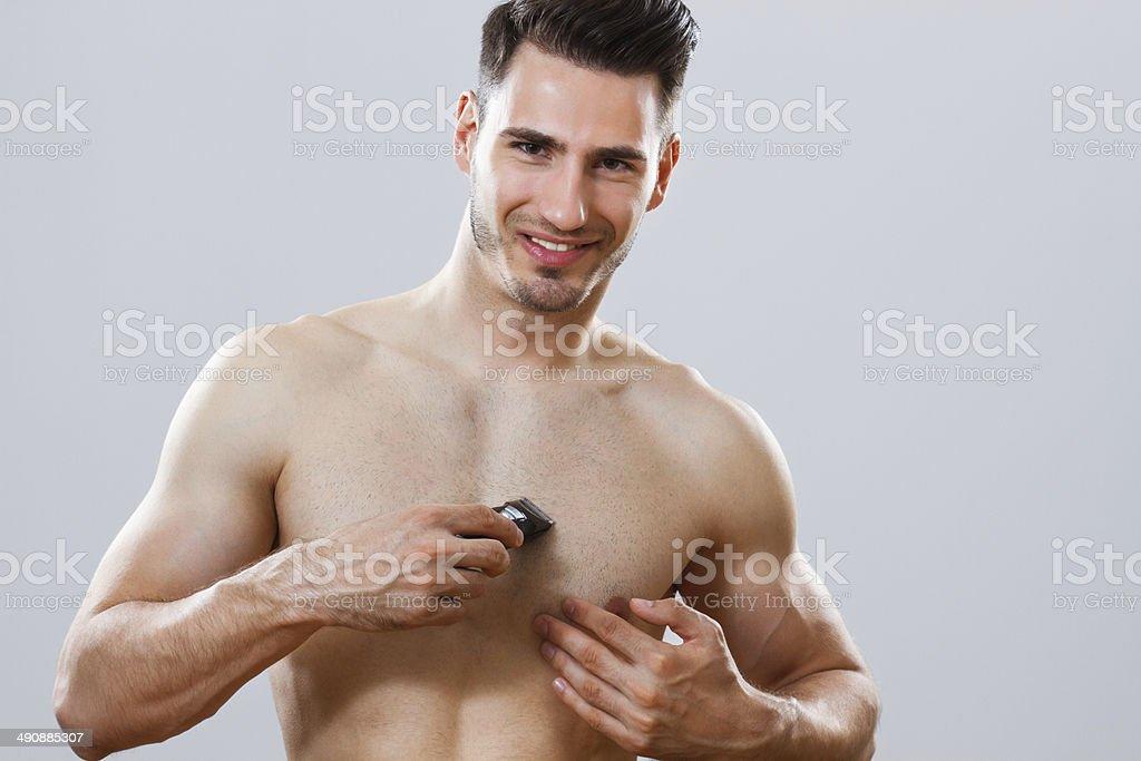 Man shaving his chest royalty-free stock photo