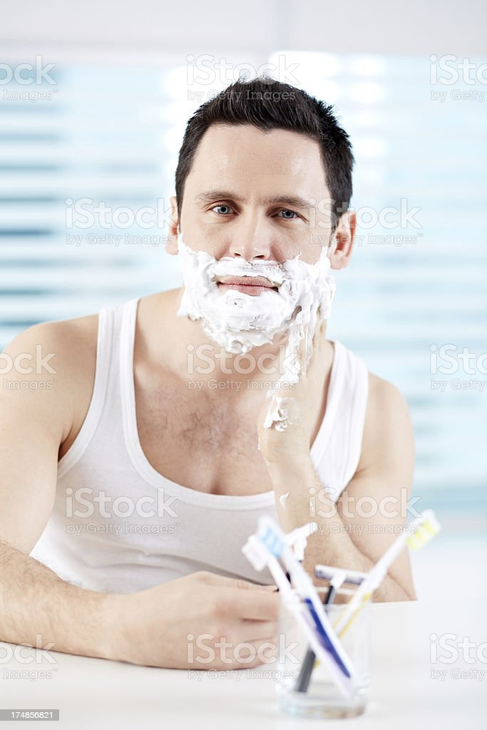 Man shaving royalty-free stock photo