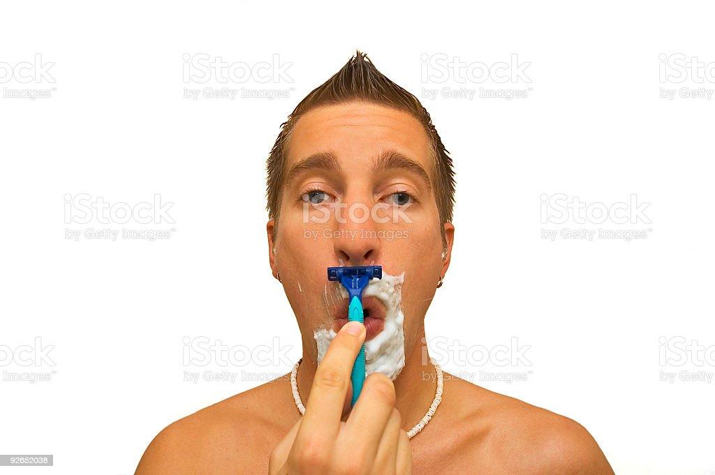 man shaving royalty-free stock photo