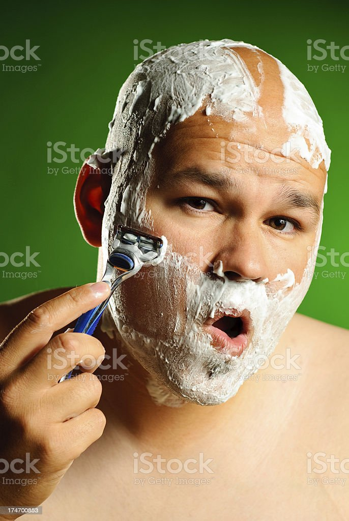 Man shaving to get ready for work royalty-free stock photo