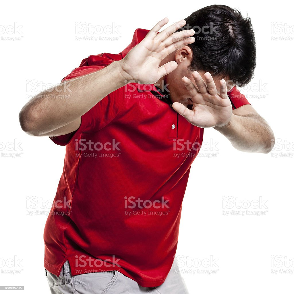 Man Shields Himself From Camera With Hands royalty-free stock photo