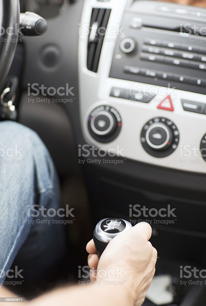 man shifting the gear on car manual gearbox royalty-free stock photo