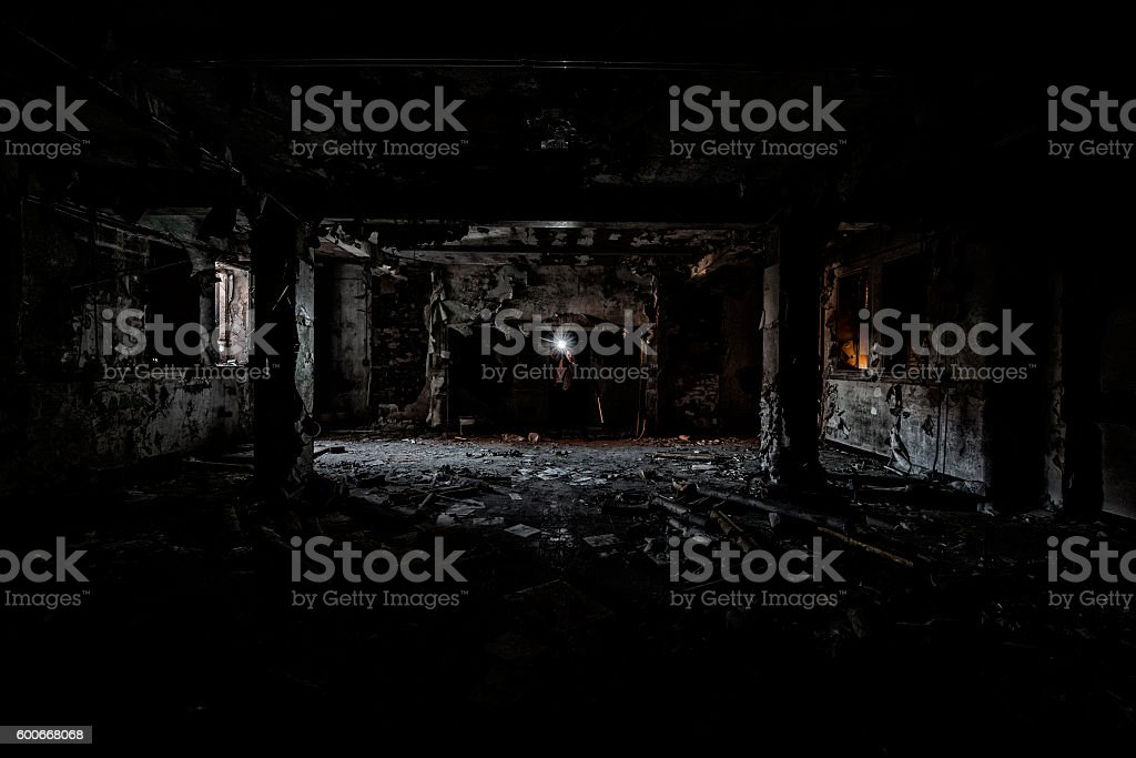 Man Shining a Light into the Darkness stock photo