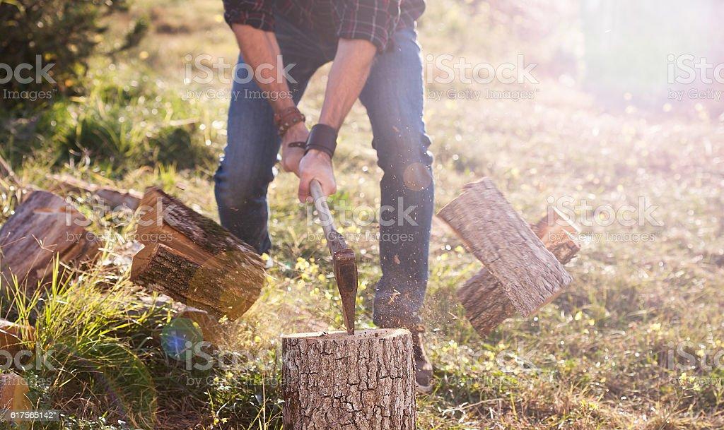 Man shirt chopping wood with axe stock photo