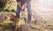 Man shirt chopping wood with axe
