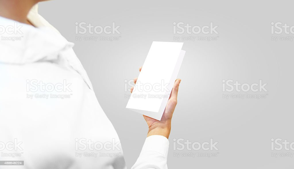 Man shirt holding blank brochure flyer in the hand. stock photo
