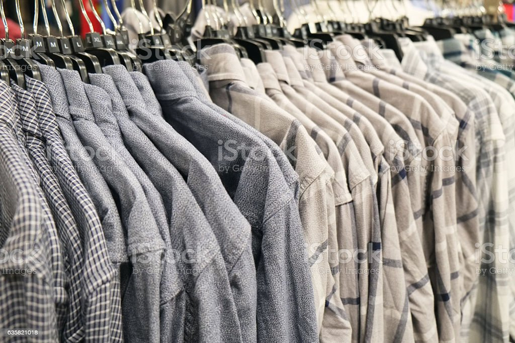 Man Shirts on Hangers for Sale stock photo