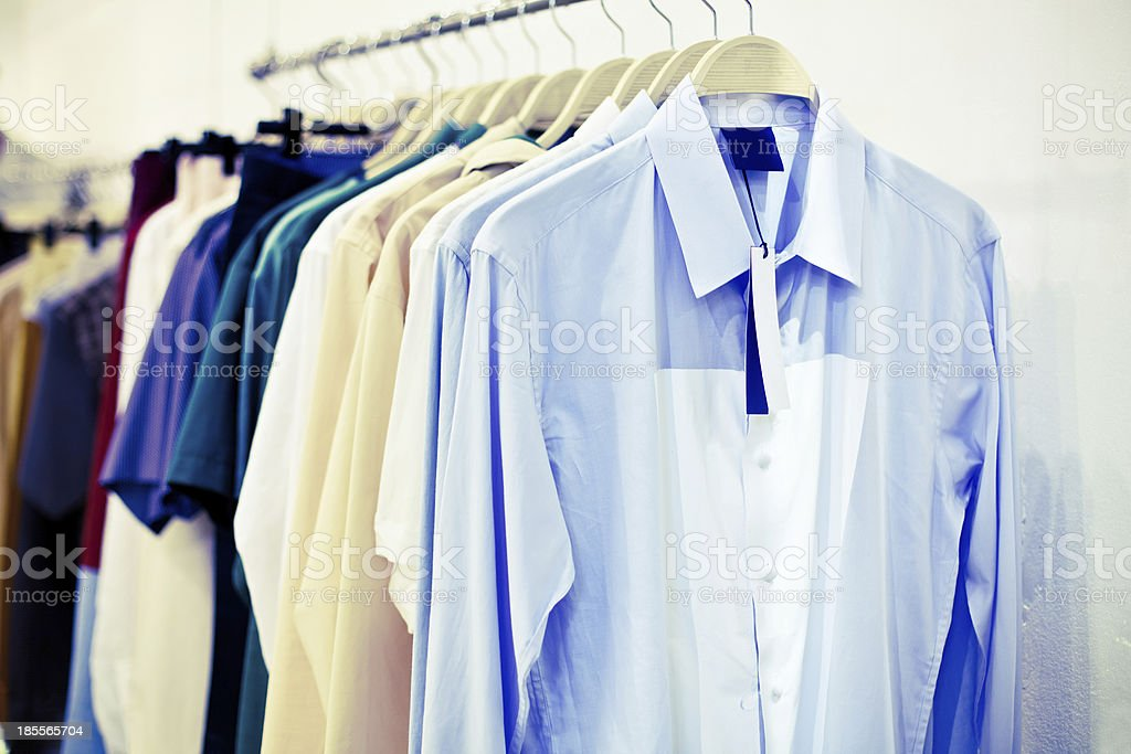man shirts with tag on hangers royalty-free stock photo