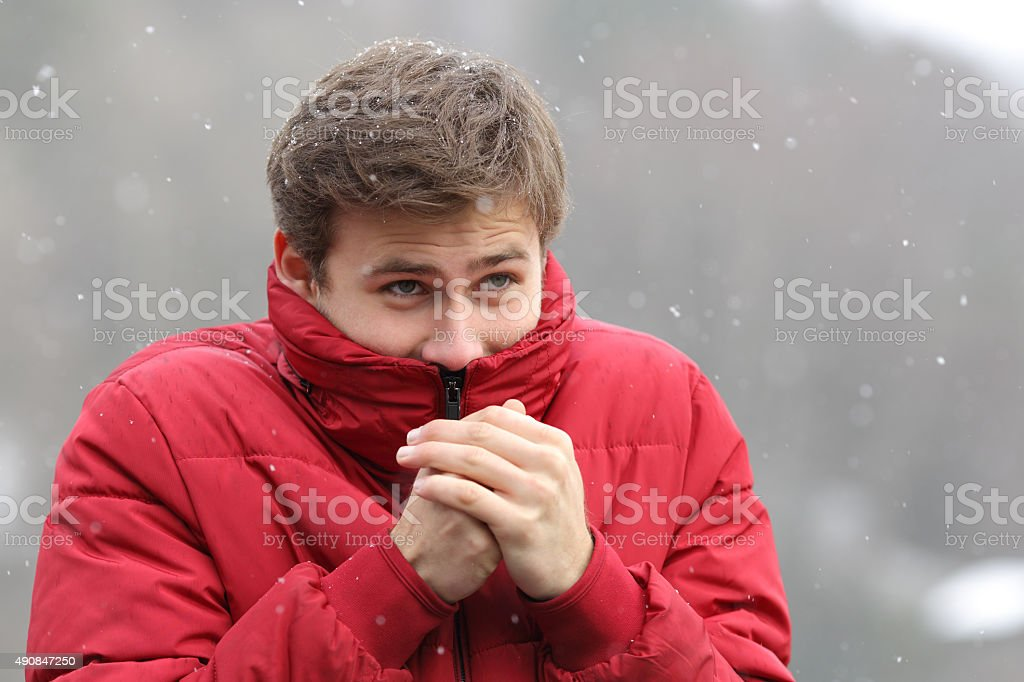 Man shivering in cold winter stock photo