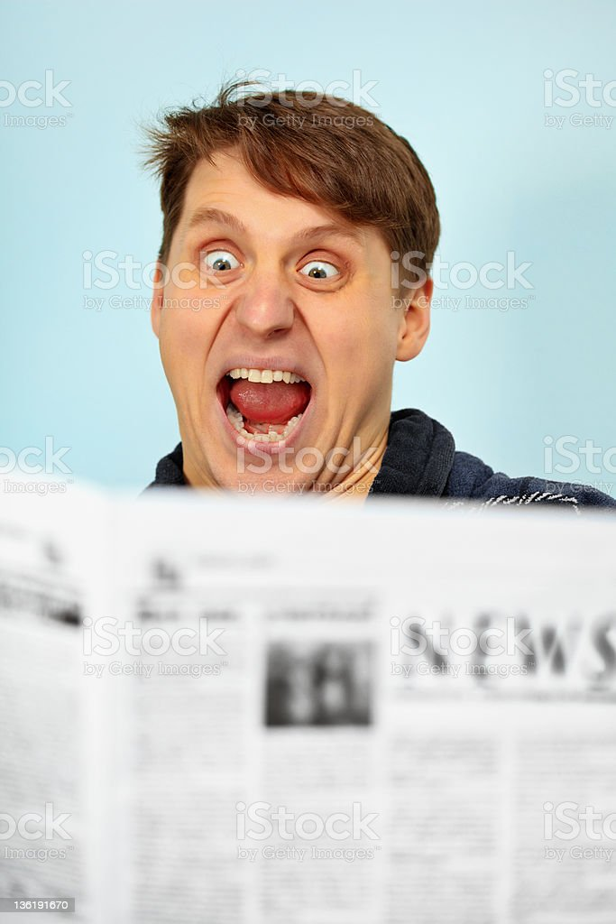 Man shocked - bad news from newspaper royalty-free stock photo