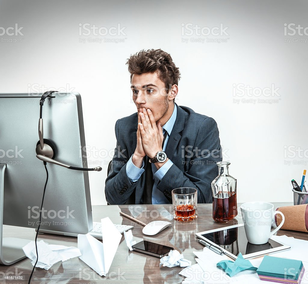 Man shocked looking what happened with his computer stock photo