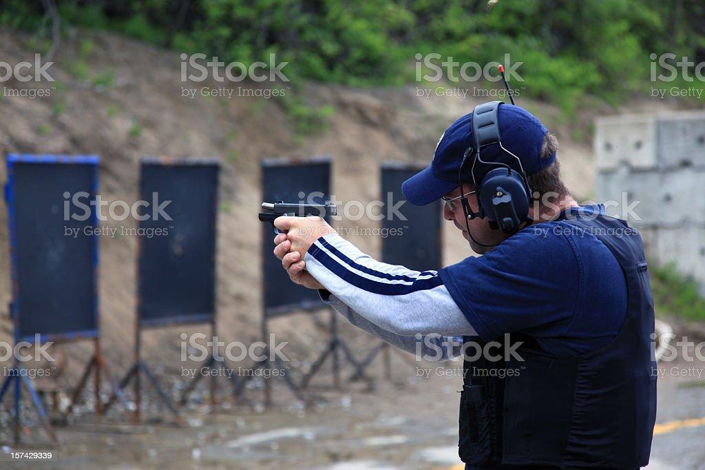 Man Shooting 9mm Handgun Shooting Range royalty-free stock photo