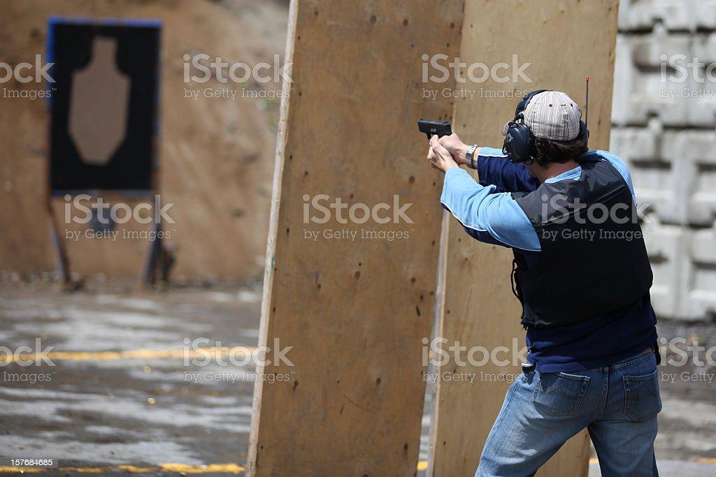 Man Shooting 9mm Handgun Shooting Range stock photo