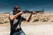 Man Shooting A 12 Gauge Shotgun