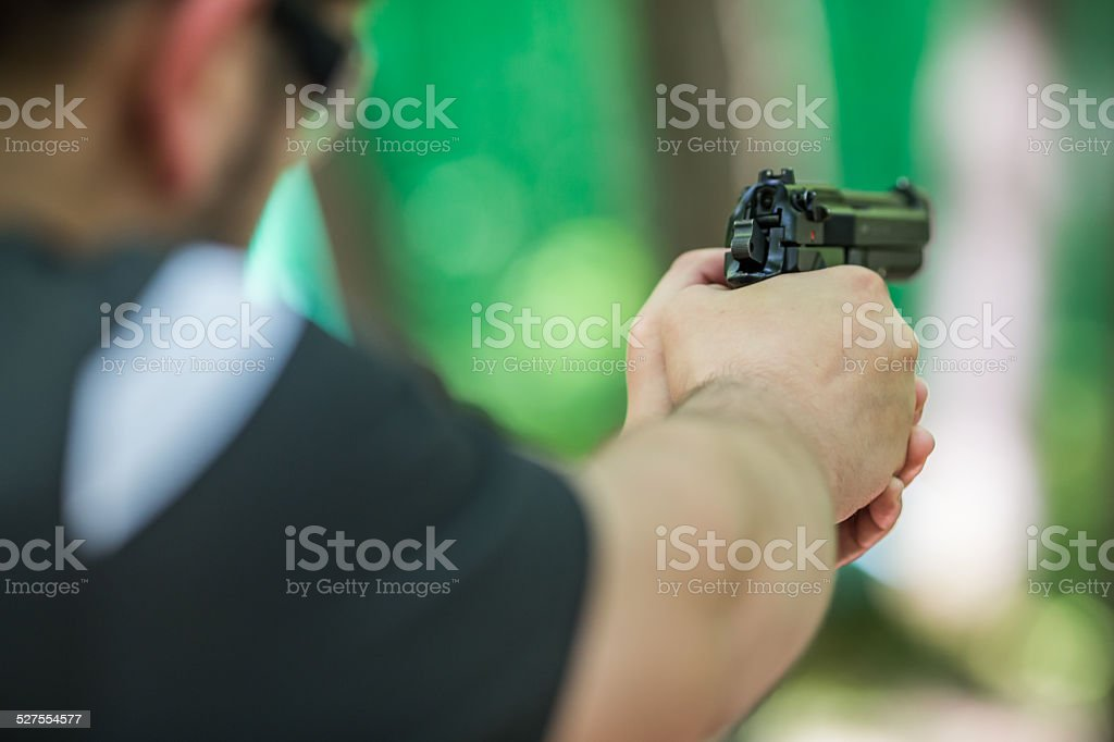 Man shooting a handgun stock photo