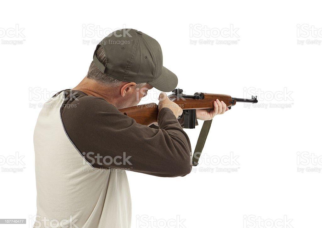 Man Shooting a Rifle stock photo