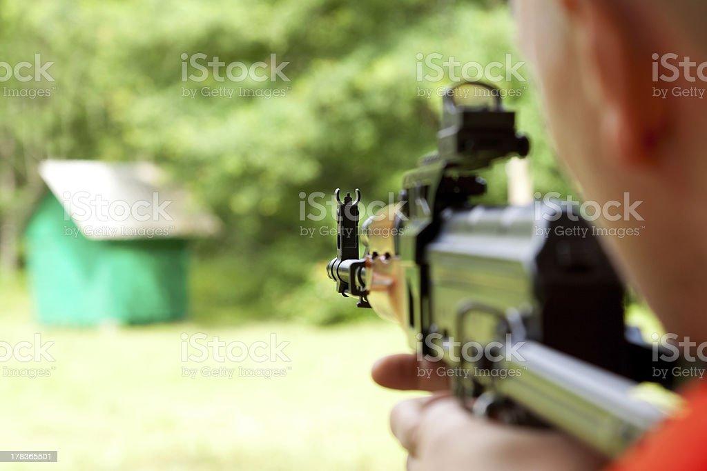 Man shooting a shotgun stock photo