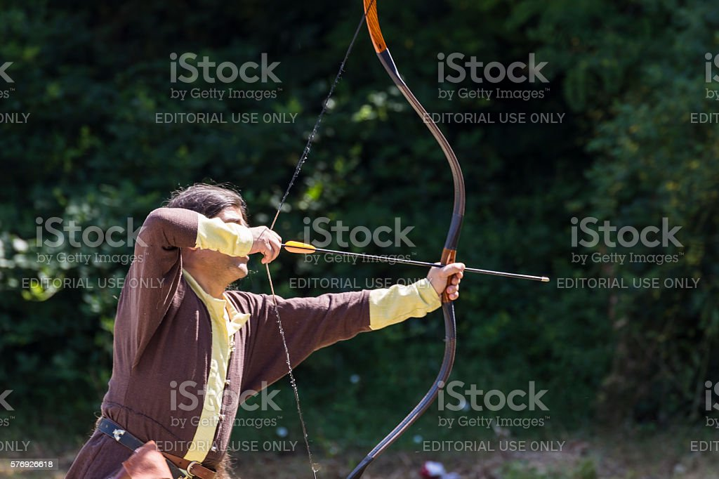 Man shooting arrows stock photo
