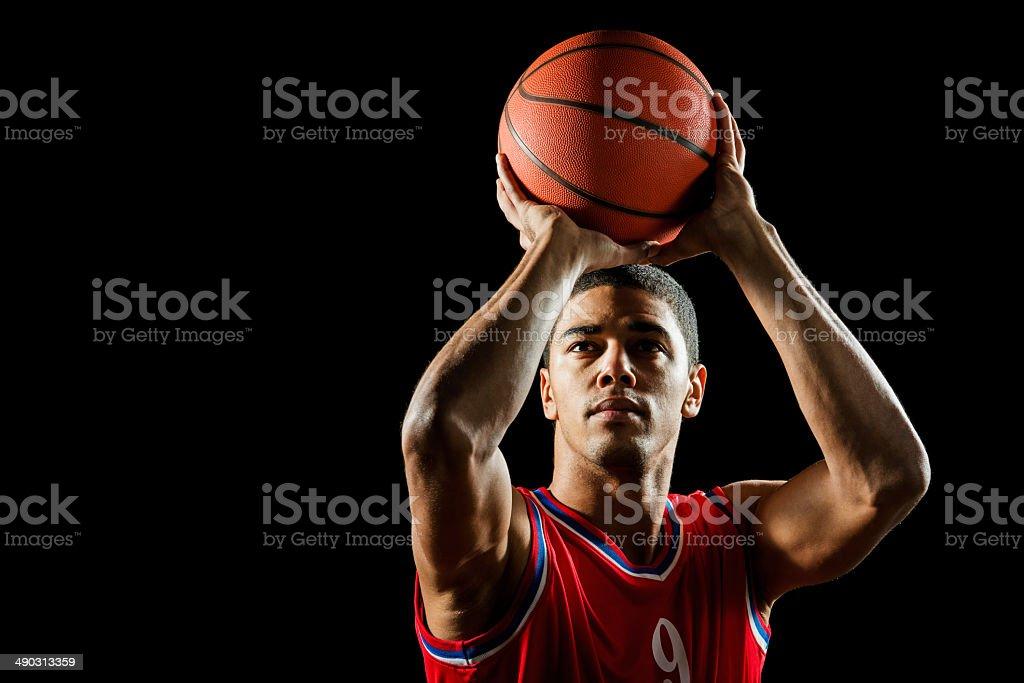 Man shooting at the hoop. stock photo