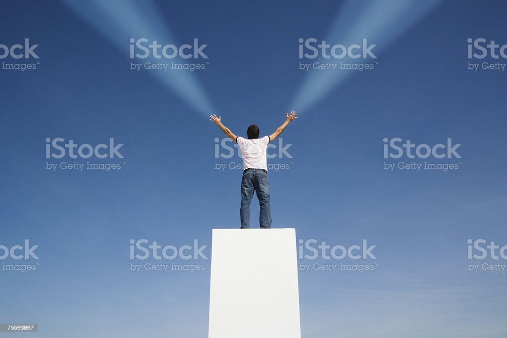 Man shooting beams of light from his hands royalty-free stock photo
