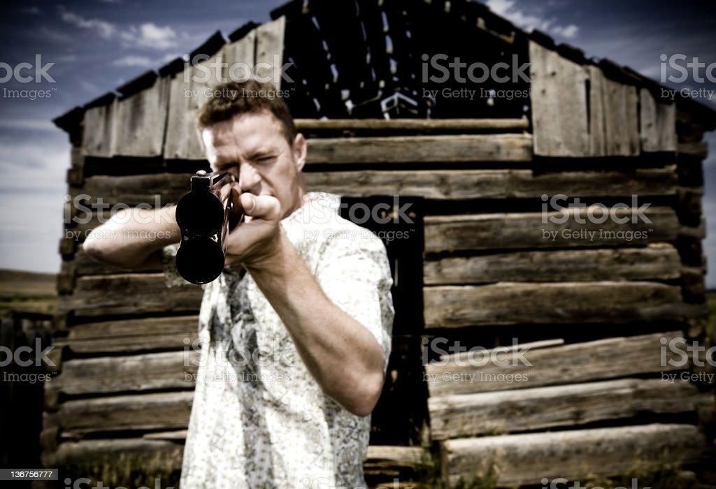 Man Shooting Gun royalty-free stock photo
