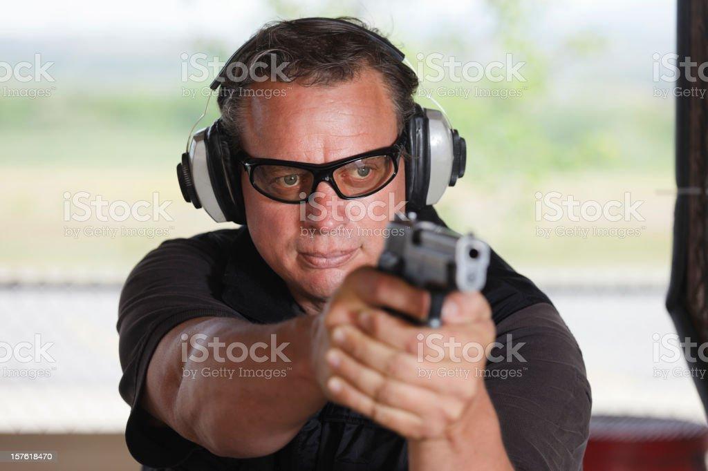 Man Shooting Handgun stock photo