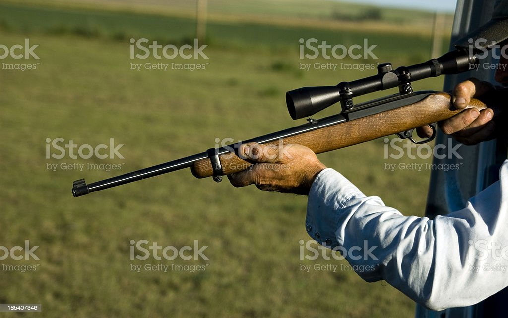 man shooting rifle royalty-free stock photo