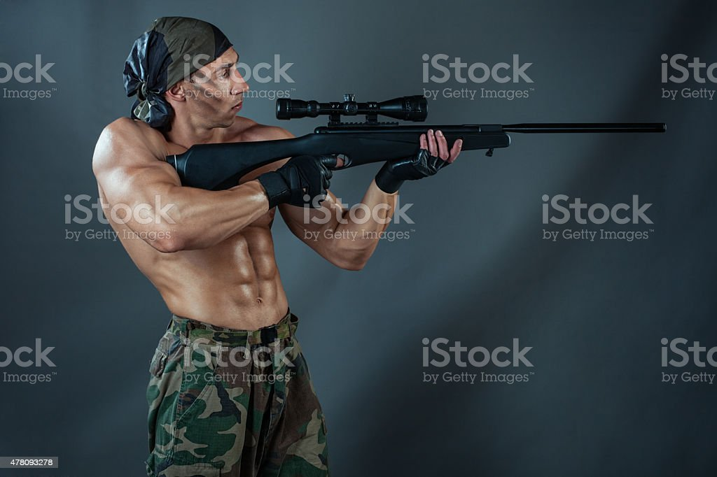 Man shoots from a rifle. stock photo