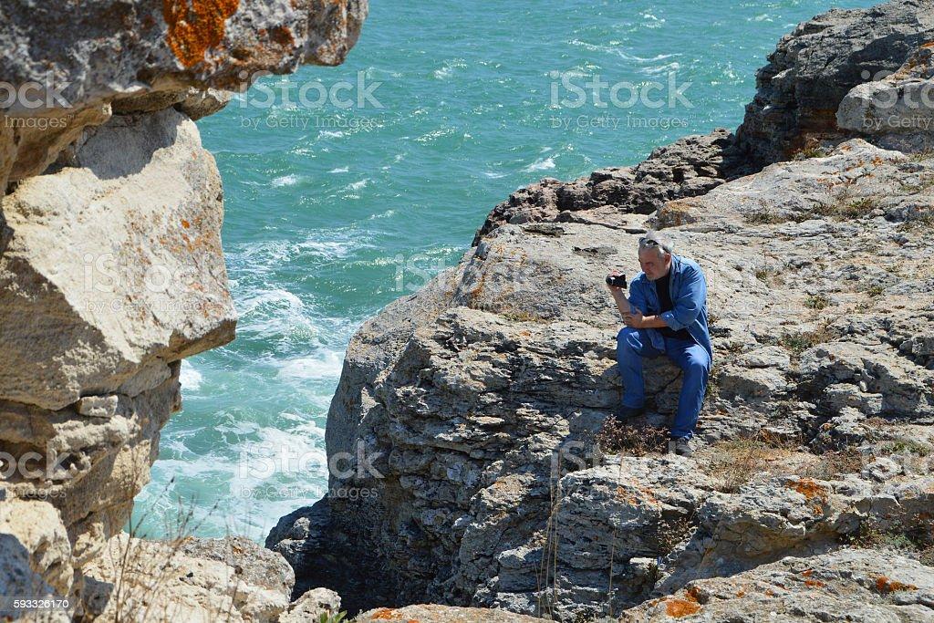 Man shoots video of the splashing sea water stock photo