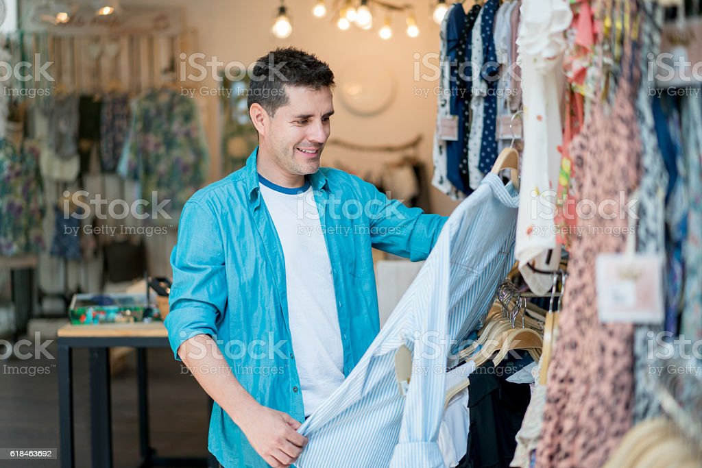 Man shopping at a clothing store stock photo