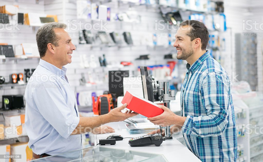 Man shopping at a tech store stock photo