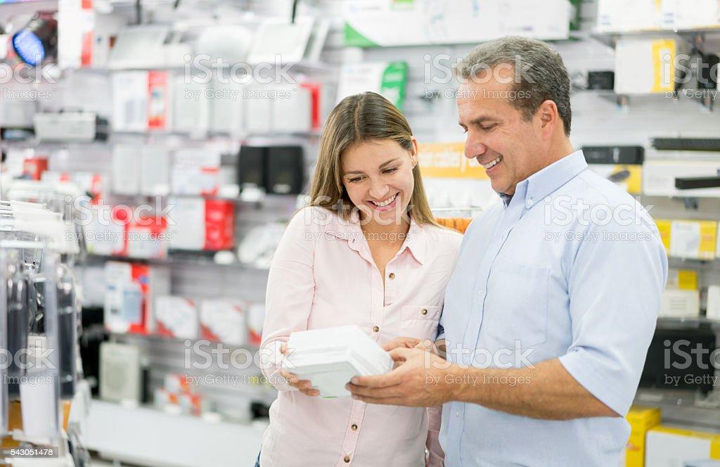 Man shopping at a tech store stock photo