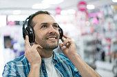 Man shopping at an electronics store