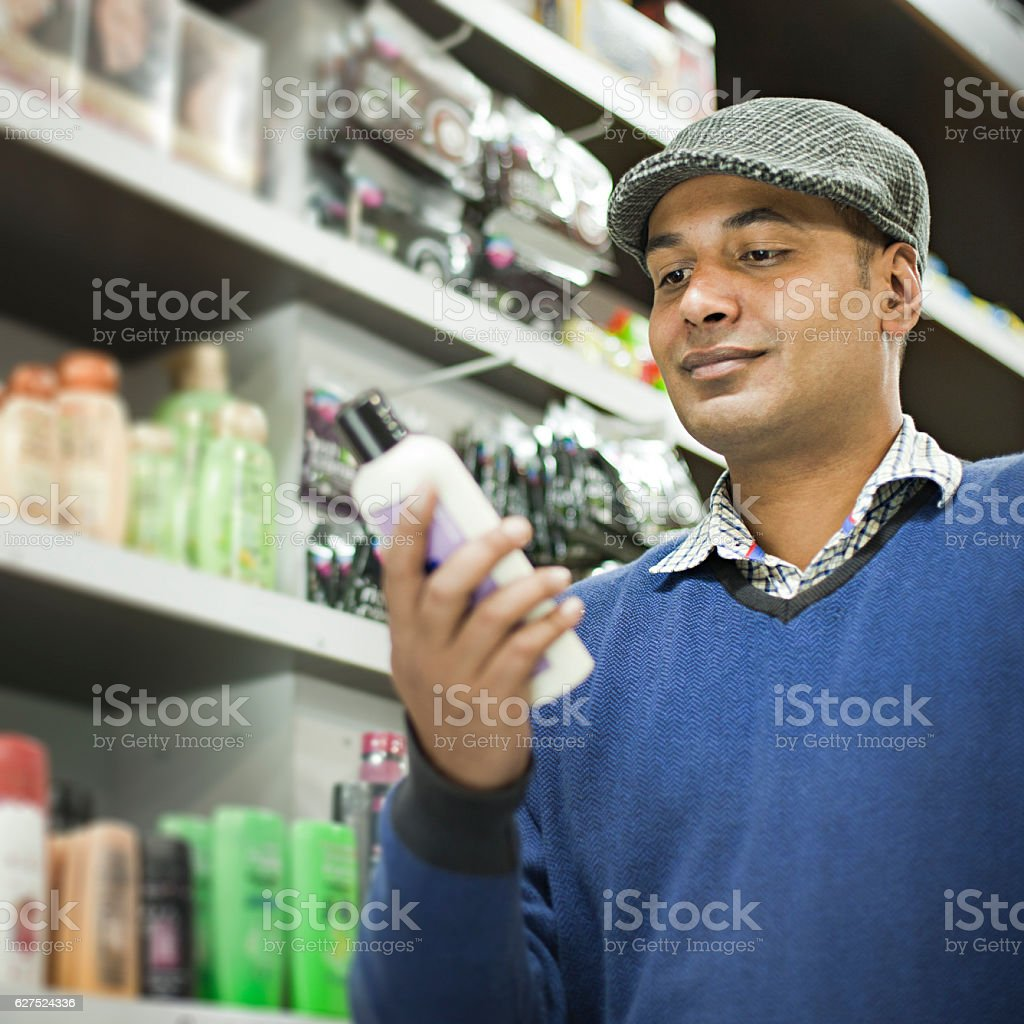 Man shopping at supermarket. stock photo