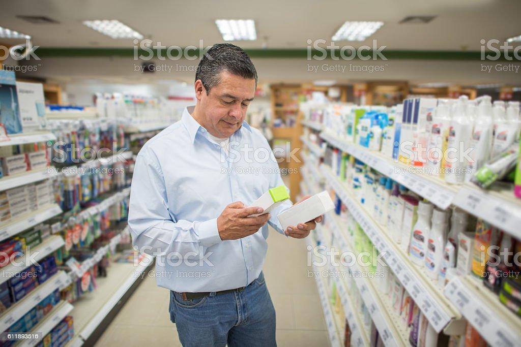 Man shopping at the pharmacy stock photo