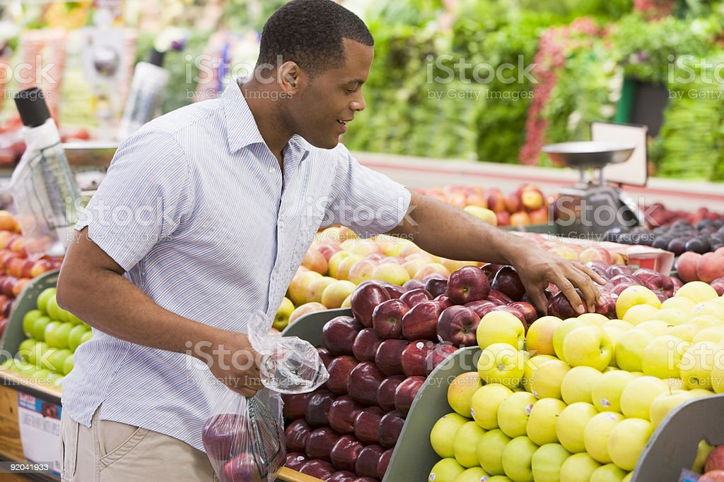 Man shopping in produce section stock photo