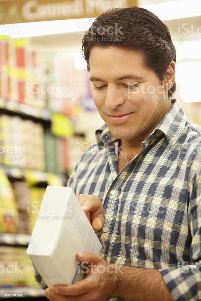 Man shopping in supermarket royalty-free stock photo