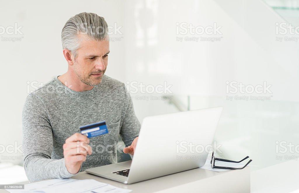 Man shopping online stock photo