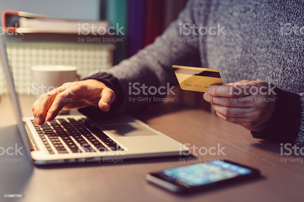 Man shopping online with credit card stock photo