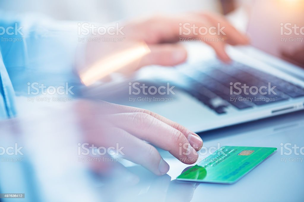 Man shopping online with his laptop stock photo