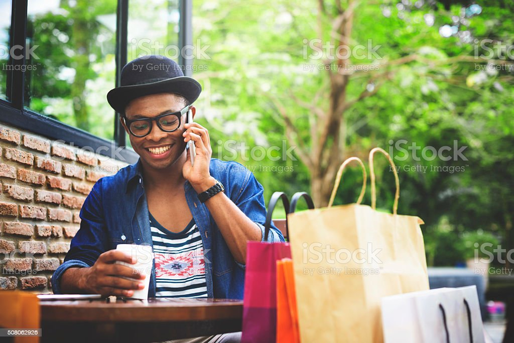 Man Shopping Outdoor Talking Mobile Phone Concept stock photo