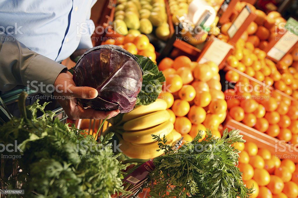 Man Shopping Produce and Fruit at Grocery Store Supermarket stock photo