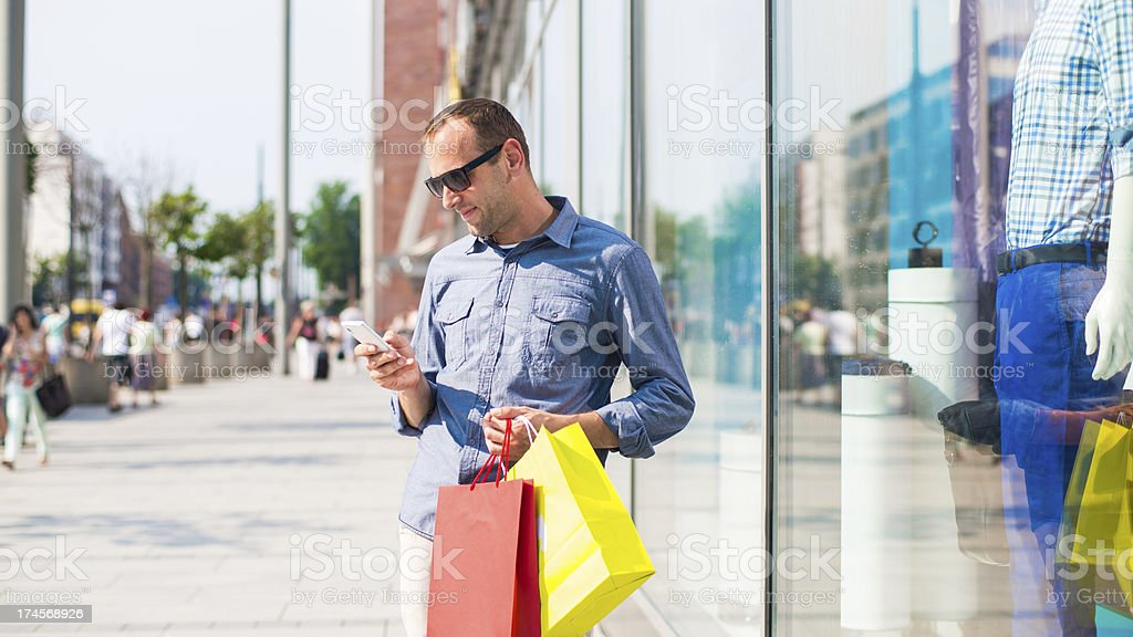 Man shopping with many colored bags in his hand. royalty-free stock photo