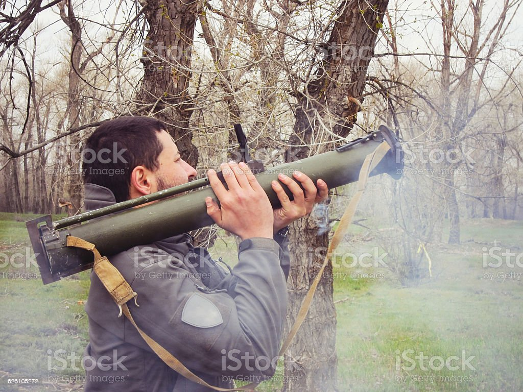 man shot from a grenade launcher stock photo