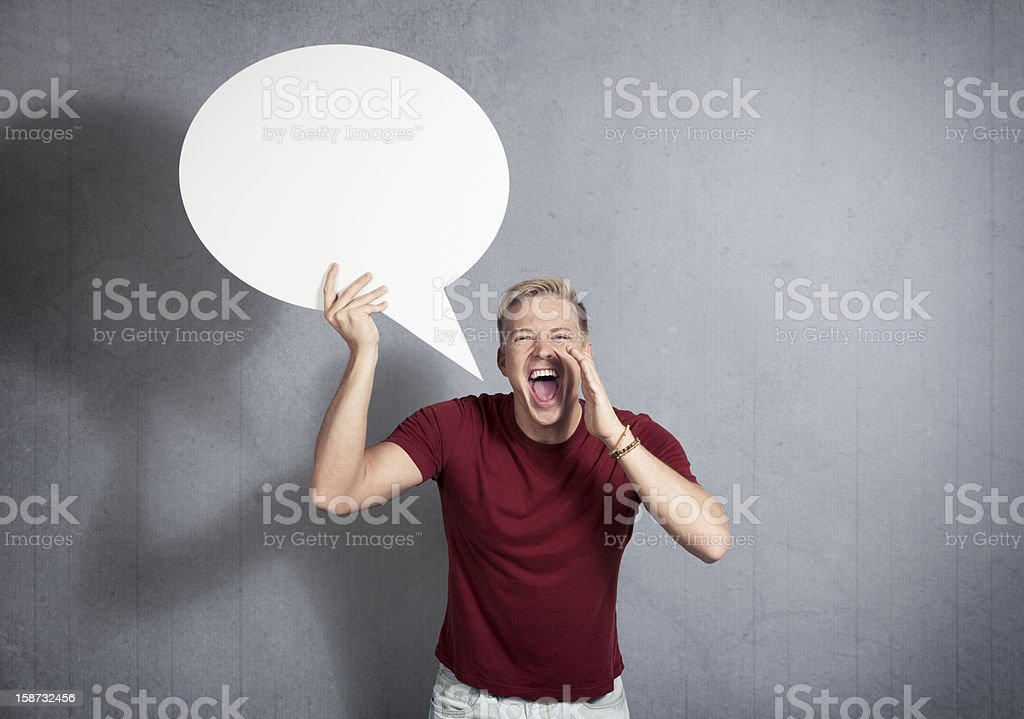 Man shouting  with empty speech ballon in hand. royalty-free stock photo