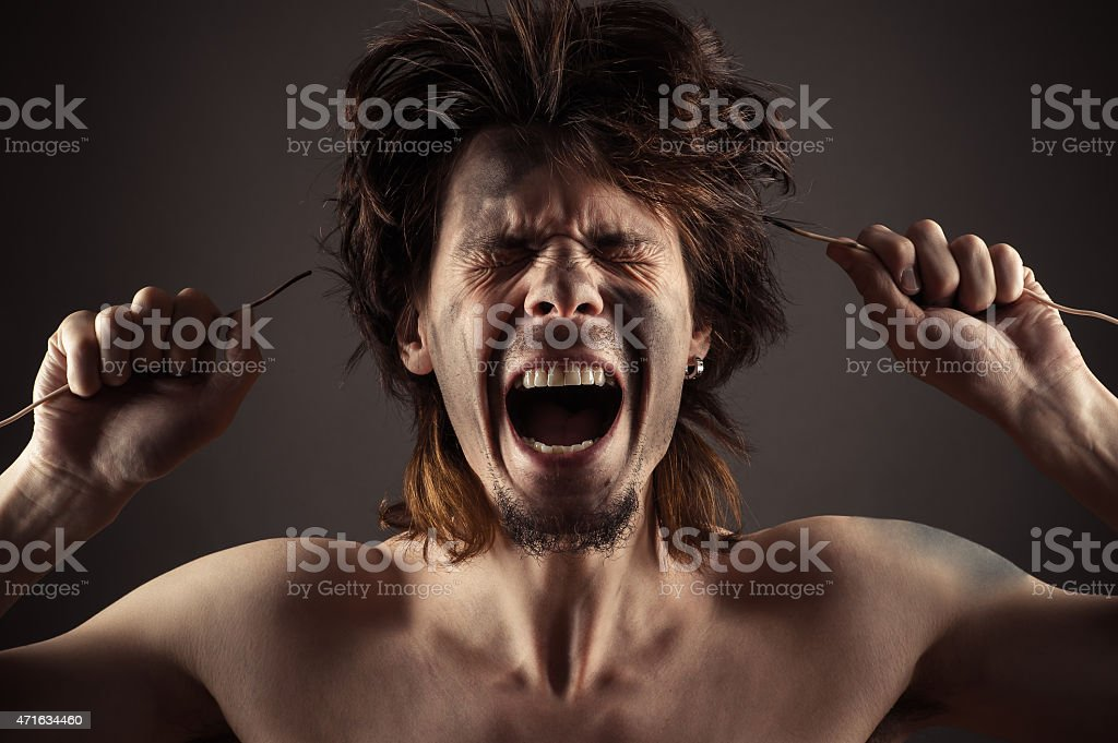 man shouts a problem with electricity stock photo