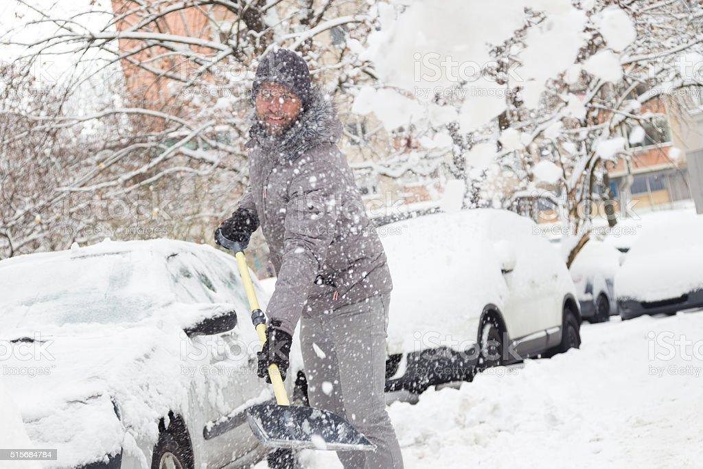 Man shoveling snow in winter. stock photo