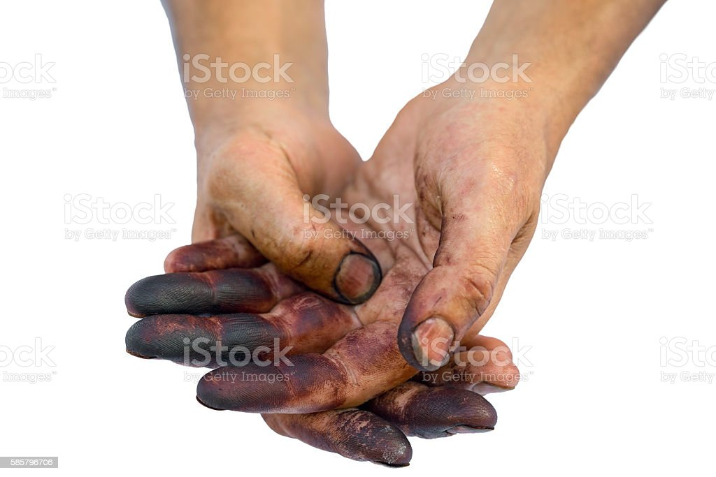 Man show his dirty hands isolated on white. stock photo