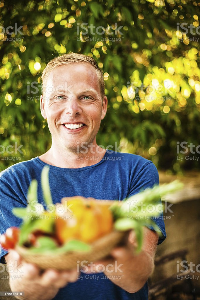 Man showing a basket of healthy choice food stock photo