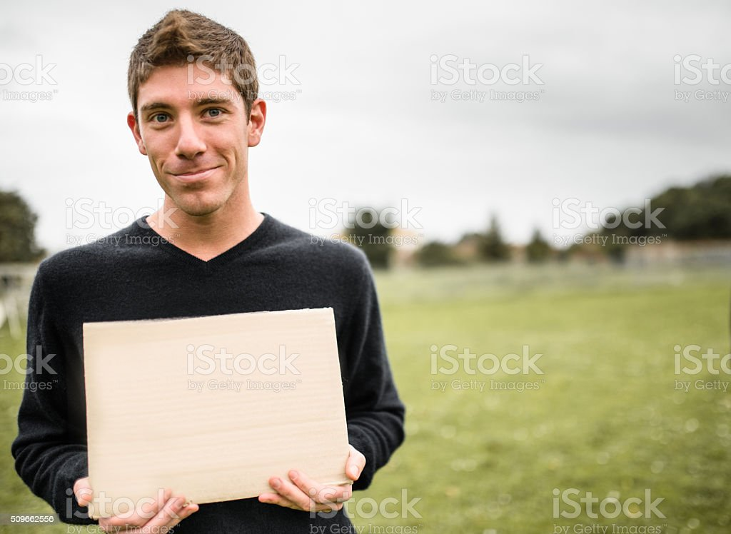 man showing a blank banner stock photo